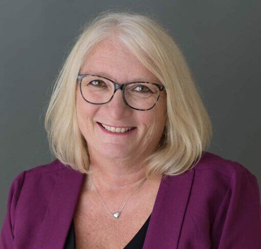 OPSBA President Cathy Abraham in a purple blazer